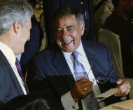 U.S. Defense Secretary Panetta shares a light moment with Australia&#39;s Defence Minister Smith before the opening of the 11th IISS Asia Security Summit: The Shangri-La Dialogue in Singapore