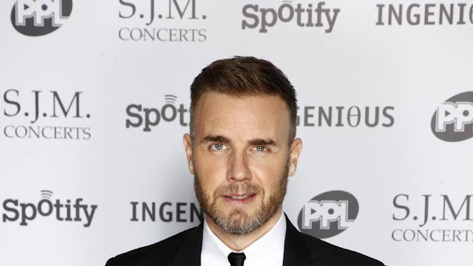 Gary Barlow arriving at the 2012 Music Industry Trusts Award ceremony at the Grosvenor House Hotel on Monday, Nov. 5, 2012, in London. (Photo by John Marshall JM Enternational/Invision/AP)