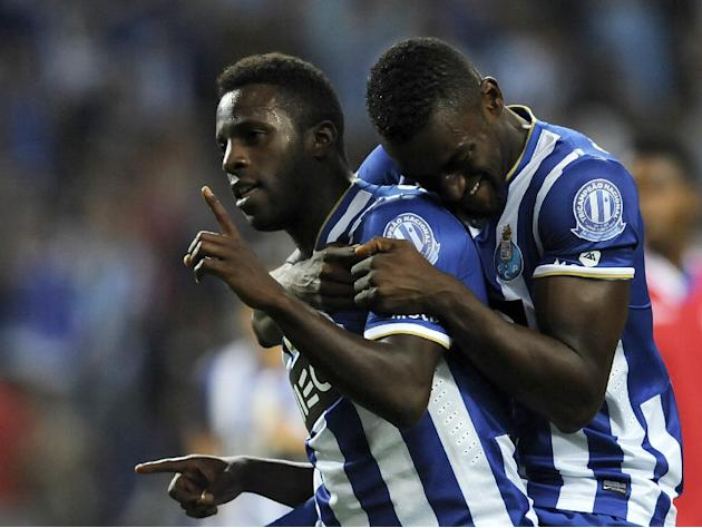 FC Porto's Silvestre Varela, left, celebrates with Jackson Martinez, from Colombia, after scoring against Gil Vicente in a Portuguese League soccer match at the Dragao stadium in Porto, Portugal, Satu