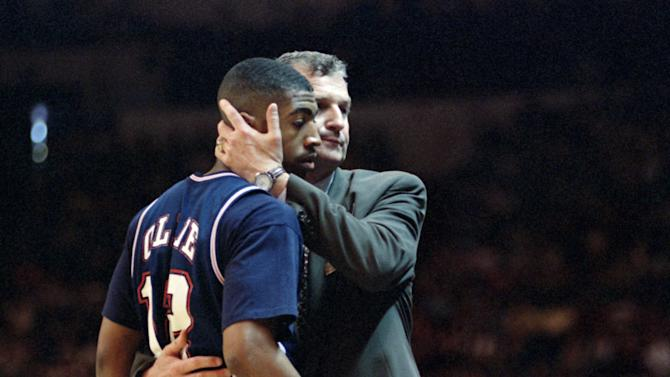 FILE - This March 25, 1995 file photo shows Connecticut head coach Jim Calhoun hugging Kevin Ollie in the last minute of a 102-96 loss to UCLA in the NCAA West Regional Championship at the Oakland Coliseum in Oakland, Calif. Calhoun is officially retiring, Thursday, Sept. 13, 2012,  as men's basketball coach at Connecticut after a 40-year college career and three national championships. Assistant coach Kevin Ollie, who played point guard for Calhoun from 1991-95, will be the Huskies' new coach. (AP Photo/Susan Ragan, File)
