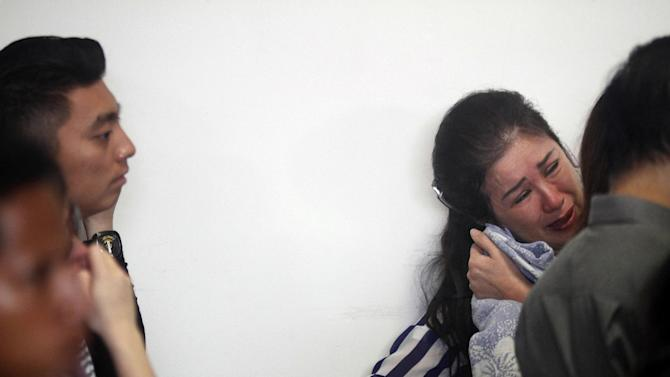 One of relatives and next-of-kin of passengers on board the AirAsia flight QZ8501 cries as she awaits the latest news on the search of the missing jetliner at Juanda International Airport in Surabaya, East Java, Indonesia, Monday, Dec. 29, 2014. Search planes and ships from several countries on Monday were scouring Indonesian waters over which an AirAsia jet disappeared, more than a day into the region's latest aviation mystery. AirAsia Flight 8501 vanished Sunday in airspace thick with storm clouds on its way from Surabaya, Indonesia, to Singapore. (AP Photo/Trisnadi Marjan)