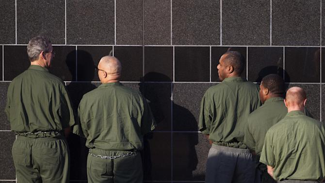 R. Allen Stanford, left, enters the Bob Casey Federal Courthouse where he was sentenced to 110 years in prison for being involved in a Ponzi scheme causing investors to lose their money Thursday, June 14, 2012, in Houston. (AP Photo/Houston Chronicle, Johnny Hanson)