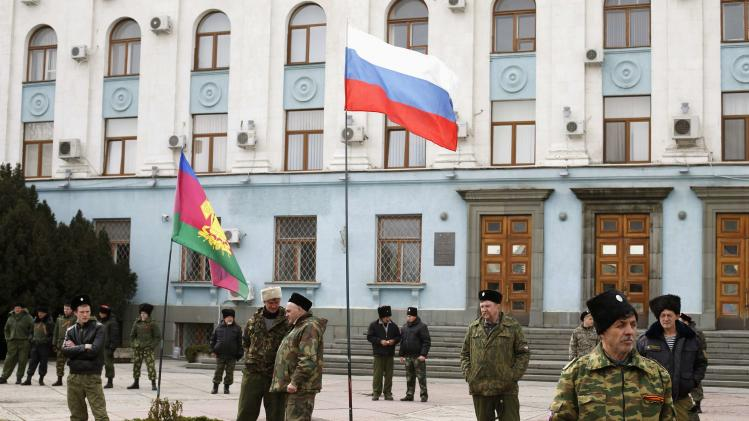 Cossacks stand guard in front of a building of Council of Ministers in Simferopol