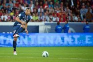 Paris Saint-Germain's forward Swedish Zlatan Ibrahimovic kicks the ball during their friendly match against FC Barcelona at the Parc des Princes stadium in Paris. Paris Saint-Germain fought back to claim a 2-2 draw against Barcelona only to lose 4-1 on penalties in a pre-season friendly at the Parc des Princes
