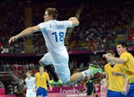 France's William Accambray jumps to shoot during the men's gold medal handball match between Sweden and France for the London 2012 Olympics Games at the Basketball Arena in London. France won the gold medal