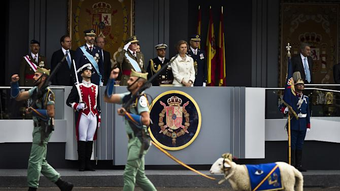 A goat, the mascot of La Legion, an elite unit of the Spanish Army, marches in front of the tribune where Spain's Crown Prince Felipe, left, Spain's King Juan Carlos, center, and Queen Sofia attend a military parade, during the holiday known as Dia de la Hispanidad, Spain's National Day, in Madrid, Friday, Oct. 12, 2012. King Juan Carlos presided over a much reduced parade that featured none of the usual fighter jets or tanks as they celebrate the day Christopher Columbus discovered America in the name of the Spanish Crown.(AP Photo/Daniel Ochoa de Olza)
