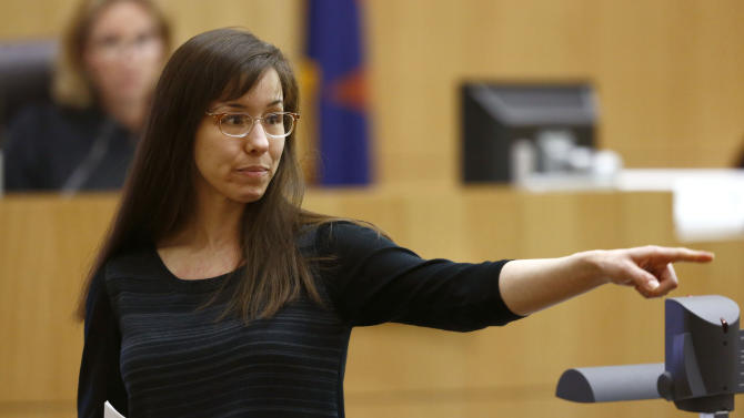 Jodi Arias points to her family as a reason for the jury to give her a life in prison sentence instead of the death penalty on Tuesday, May 21, 2013, during the penalty phase of her murder trial at Maricopa County Superior Court in PhoenixZ.  Arias was convicted of first-degree murder in the stabbing and shooting to death of Travis Alexander in his suburban Phoenix home in June 2008. (AP Photo/The Arizona Republic, Rob Schumacher, Pool)