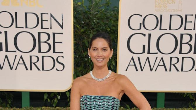 Actress Olivia Munn arrives at the 70th Annual Golden Globe Awards at the Beverly Hilton Hotel on Sunday Jan. 13, 2013, in Beverly Hills, Calif. (Photo by John Shearer/Invision/AP)