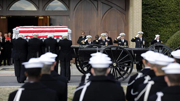 Two Navy Honor Guard teams load two caskets of remains during services to honor two sailors from the Civil War ship, the USS Monitor, as they depart Fort Meyer Memorial Chapel, Friday, March 8, 2013 in Arlington, Va. A century and a half after the Civil War ship the USS Monitor sank, two unknown crewmen found in the ironclad's turret were buried at Arlington National Cemetery. Friday's burial may be the last time Civil War soldiers are buried at the cemetery. (AP Photo/Alex Brandon)