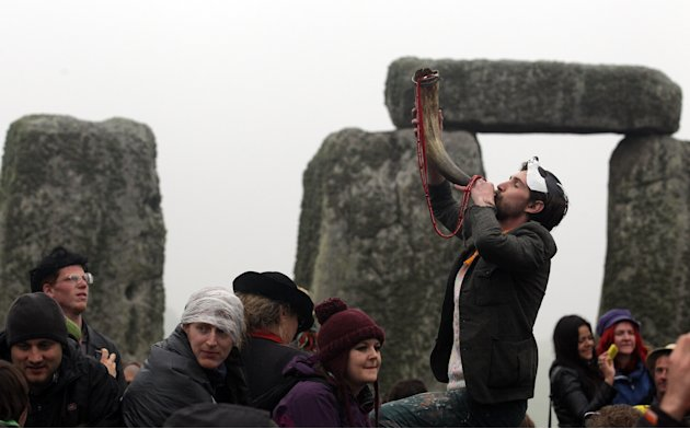 Revellers Celebrate Summer Solstice At Stonehenge