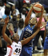 Minnesota Lynx player Maya Moore, 23, battles Washington Mystics' Noelle Quinn, 45, for the rebound during their basketball game at the Verizon Center, Wednesday, May 30, 2012, in Washington. Lynx defeated the Mystics 79-77. (AP Photo/Richard Lipski)