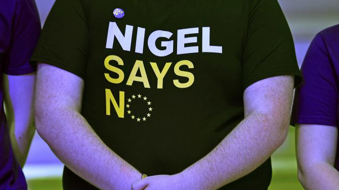 A supporter wears a tee-shirt as he waits for Farage, the leader of Britain's UKIP to speak at the launch of the party's EU referendum campaign in London