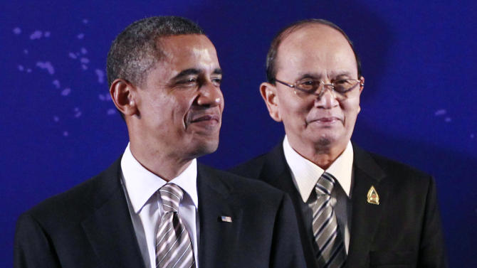 "FILE - In this Nov. 19, 2011 file photo, President Barack Obama, left, stands next to Myanmar President Thein Sein during a group photo session at the East Asia Summit in Nusa Dua, on the island of Bali, Indonesia. Thein Sein's historic White House visit next week is the culmination of U.S. outreach to a former pariah regime. That's been based on a principle of taking ""action for action"" by deepening ties in response to democratic reforms. (AP Photo/Charles Dharapak, File)"