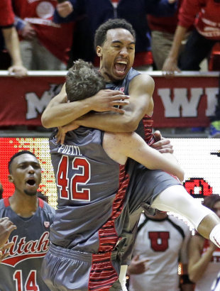 Utah guard Brandon Taylor, right, celebrates with forward Jakob Poeltl. (AP)