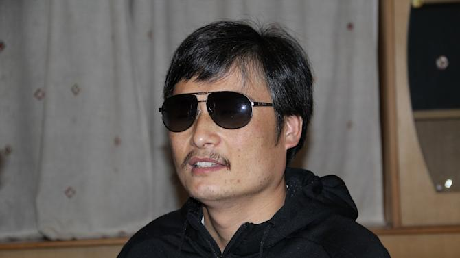 In this photo taken in late April, 2012, and released by Zeng Jinyan, blind Chinese legal activist Chen Guangcheng is seen at an undisclosed location in Beijing during a meeting with human rights activists Hu Jia and Zeng Jinyan. Chen, an inspirational figure in China's rights movement, slipped away from his well-guarded rural village on April 22, 2012, and made it to a secret location in Beijing on Friday, April 27. Activists say Chen is under the protection of U.S. diplomats in Beijing. (AP Photo/Zeng Jinyan)
