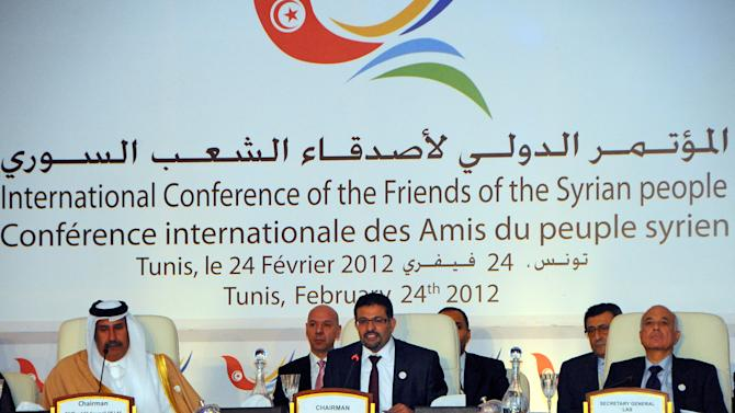 Tunisian foreign minister Rafik Abdessalem, center opens the Conference on Syria in Tunis, Tunisia, Friday Feb. 24, 2012.The birthplace of the Arab Spring hosts a landmark conference on Syria by high-level U.S., European, Turkish and Arab League officials. Sitting at left is Qatar foreign minister Sheikh Hamad bin Jassim bin Jabor Al-Thani, and at right General Secretary of the Arab League Nabil-al-Arabi.(AP Photo/Hassene Dridi)