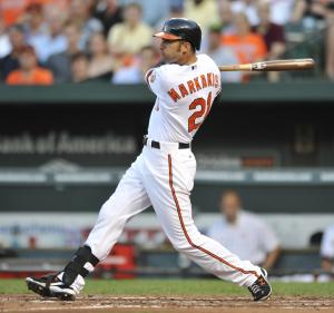 Baltimore Orioles' Nick Markakis follows through on a two-run single against the Cleveland Indians in the third Inning of a baseball game Thursday, July 14, 2011, in Baltimore. The Indians won 8-4.(AP Photo/Gail Burton)