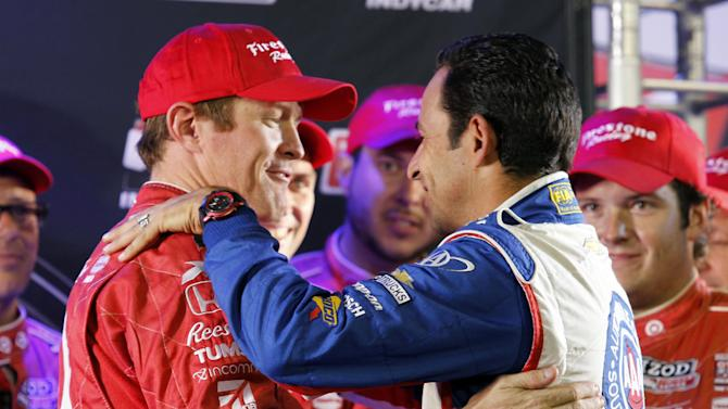 Helio Castroneves, right, of Brazil, congratulates Scott Dixon, of New Zealand, for winning the IndyCar Series Championship after finishing fifth in the Indy Car auto race at the Auto Club Speedway, Saturday, Oct. 19, 2013, in Fontana, Calif. (AP Photo/Alex Gallardo)