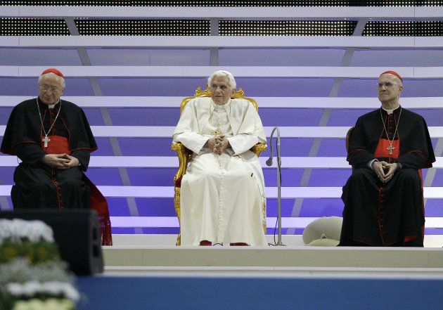 Pope Benedict XVI, is flanked by Vatican secretary of state cardinal Tarcisio Bertone, right, and cardinal Ennio Antonelli, left, prior to delivering his speech in Bresso, near Milan, Italy, Saturday,