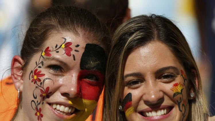 Germany fans pose before the 2014 World Cup final between Argentina and Germany at the Maracana stadium in Rio de Janeiro