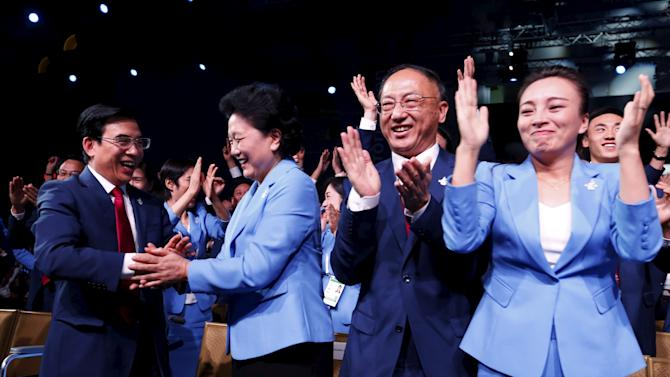 China's Vice Premier Liu Yandong celebrates with members of the Beijing delegation after the city was elected to host the 2022 Olympic Winter Games at IOC meeting in Kuala Lumpur