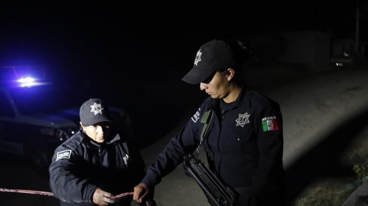 Local police secure the area after dangerous radioactive medical material were found on a truck in Hueypoxtla