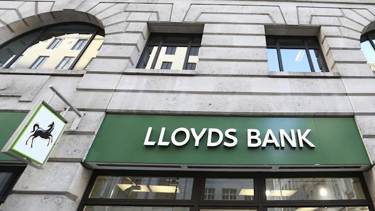 The signage is seen at a branch of Lloyds bank in central London