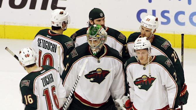 Minnesota Wild players react  after their loss to the Chicago Blackhawks 5-1 in Game 5 of an NHL hockey Stanley Cup first-round playoff series in Chicago, Thursday, May 9, 2013. (AP Photo/Nam Y. Huh)