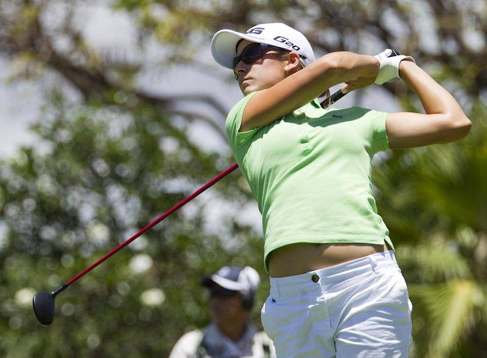 Azahara Munoz, of Spain, watches her drive off the 10th tee in the third round of the LPGA LOTTE Championship golf tournament at Ko Olina Golf Club, Friday, April 20, 2012, in Kapolei, Hawaii. (AP Photo/Eugene Tanner)