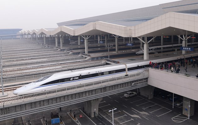 In this photo released by China's Xinhua news agency, a high-speed train G90 leaves for Beijing from the Zhengzhou East Railway Station in Zhengzhou, capital of central China's Henan Province, Wednesd
