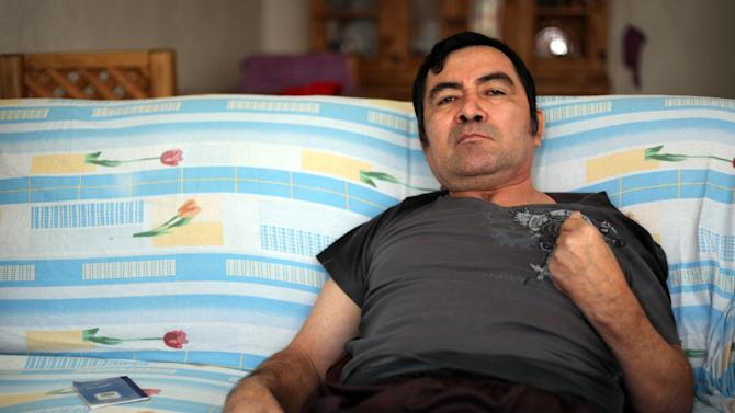 In this Thursday March 7, 2013 photo, Jacinto Rodriguez Cruz, 49, sits on a sofa inside his home in the city of Veracruz, Mexico.  Cruz and another friend suffered serious injuries during a car accident last May 2008 in northwestern Iowa. After their employers insurance coverage ran out, Cruz, who was not a legal citizen, was placed on a private airplane and flown to Mexico still comatose and unable to discuss his care or voice his protest. Hospitals confronted with absorbing the cost of caring for uninsured seriously injured immigrants are quietly deporting them, often unconscious and unable to protest, back to their home countries. (AP Photo/Felix Marquez)