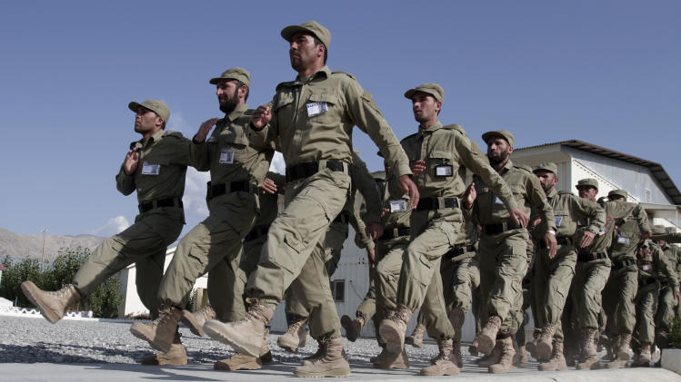 Afghan local policemen march during a training exercise at the Laghman police academy in Laghman province east of Kabul, Afghanistan, Tuesday, Oct 23, 2012. Over 150 Local police are being given training at the Laghman Academy. (AP Photo/Rahmat Gul)