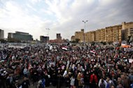Protesters chant slogans at a rally honoring those killed in clashes with security forces in Tahrir Square in Cairo, Egypt, Friday, Jan. 20, 2012, nearly a year after the 18-day uprising that ousted President Hosni Mubarak. Activists are now trying to energize the public to demand that the ruling military step down. (AP Photo/Khalil Hamra)