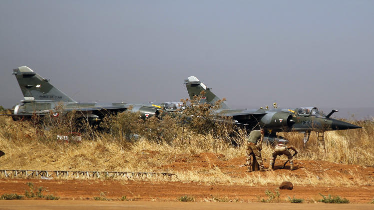 Two French  fighter jets are seen at Bamako's airport Tuesday Jan. 15, 2013.  French forces led an all-night aerial bombing campaign Tuesday to wrest control of a small Malian town from armed Islamist extremists who seized the area, including its strategic military camp. A a convoy of 40 to 50 trucks carrying French troops crossed into Mali from Ivory Coast as France prepares for a possible land assault. Several thousand soldiers from the nations neighboring Mali are also expected to begin arriving in coming days. (AP Photo/Jerome Delay)