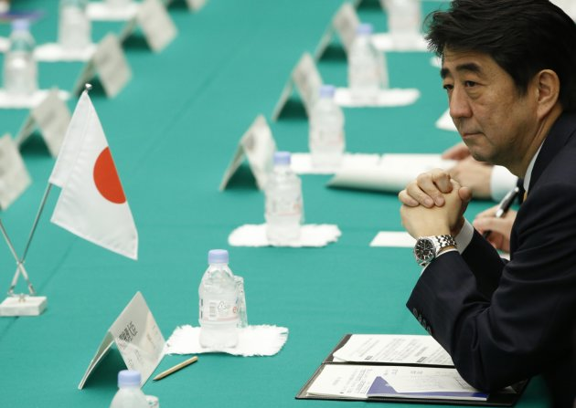 "Japan's Prime Minister Shinzo Abe attends a meeting with President of Kyrgyzstan Almazbek Atambayev (not in picture)  at Abe's official residence in Tokyo February 27, 2013. Abe appears poised to raise the curtain on Act Three of his ""Abenomics"" drama with a decision to join talks on a U.S.-led free trade pact, seen by some as a test of his appetite for vital economic reform. REUTERS/Issei Kato (JAPAN - Tags: POLITICS)"