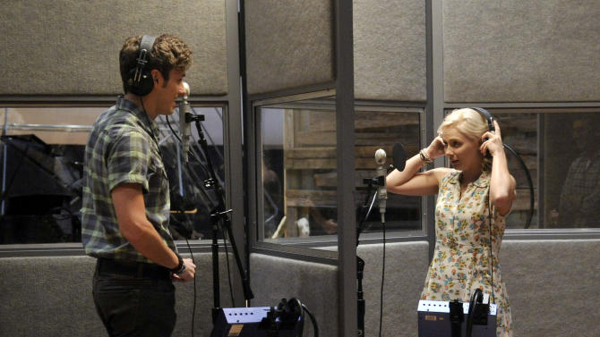 """This Aug. 20, 2012 file photo shows Sam Palladio, who portrays Gunnar Scott, left, and Clare Bowen, who portrays Scarlett O' Connor, rehearse a scene on the set of ABC's """"Nashville"""" in Nashville, Tenn. The music of """"Nashville"""" has been as much a star on the hourlong ABC drama as Connie Britton, Hayden Panettiere, Charles Esten, Jonathan Jackson, Bowen and Palladio. Each actor sings their own part, and so far fans seem to be responding, buying more than 800,000 digital singles.  (Photo by Donn Jones/Invision, file)"""