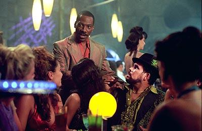 Eddie Murphy and Luis Guzman in The Adventures of Pluto Nash