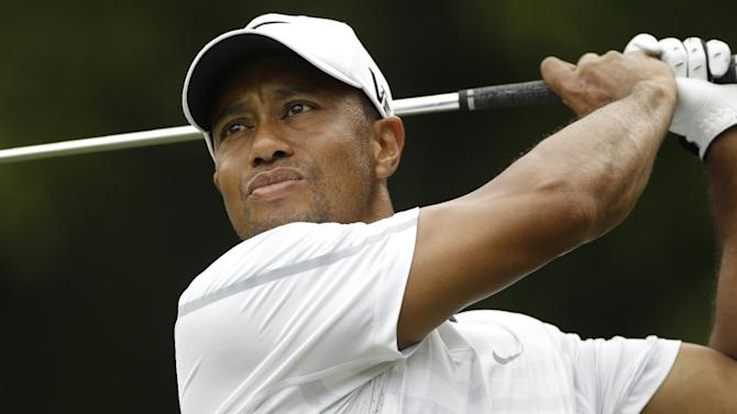 Tiger Woods hits from the eighth tee during the third round of The Players championship golf tournament at TPC Sawgrass, Saturday, May 11, 2013 in Ponte Vedra Beach, Fla. (AP Photo/Gerald Herbert)