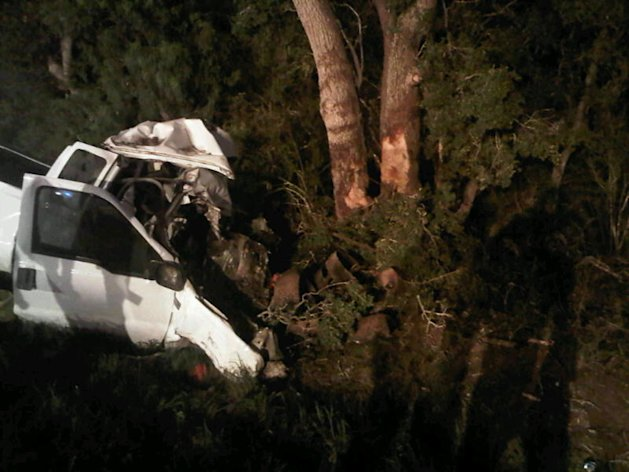 In a photo provided by the Texas Department of Public Safety the wreckage of a pickup truck is seen after it crahed into trees In Goliad County Texas Sunday July 22, 2012. The single vehicle crash in rural South Texas killed at least 11 people and injured 12 others, all passengers in the truck. (AP Photo/Texas Department of Public Safety)