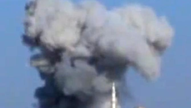 This image taken from video obtained from the Shaam News Network, which has been authenticated based on its contents and other AP reporting, purports to show smoke rising due to heavy bombings from military warplanes, not pictured, in Idlib province, northern Syria, on Tuesday, Oct. 16, 2012. Syrian government warplanes unleashed deadly airstrikes on rebel strongholds in the country's north on Tuesday, activists reported. (AP Photo/Shaam News Network via AP video)
