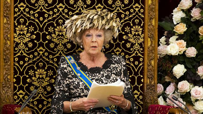 """Dutch Queen Beatrix formally opens the new parliamentary year with a speech outlining the government's plans for its 2013 budget,  in The Hague, Netherlands, Tuesday, Sept. 18, 2012. The Netherlands' Queen Beatrix underlined her country's commitment to the euro during her annual address to Parliament about the national budget on Tuesday, and made it clear the country will continue to pursue """"austerity"""" policies in response to Europe's debt crisis. (AP Photo/Vincent Jannink)"""