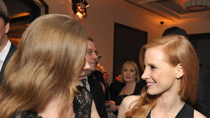 Amy Adams, left, and Jessica Chastain attend The Hollywood Reporter Nominees' Night at Spago on Monday, Feb. 4, 2013, in Beverly Hills, Calif. (Photo by John Shearer/Invision for The Hollywood Reporter/AP Images)