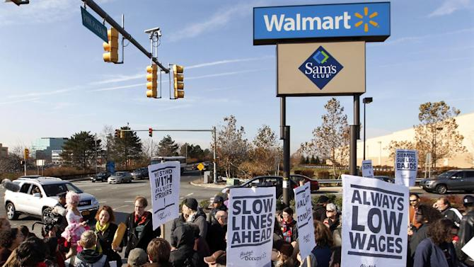 A large gathering protests against Wal-Mart on Black Friday, Nov 23, 2012, in Secaucus, N.J.  Wal-Mart employees and union supporters are taking part in today's nationwide demonstration for better pay and benefits A union-backed group called OUR Walmart, which includes former and current workers, was staging the demonstrations and walkouts at hundreds of stores on Black Friday, the day when retailers traditionally turn a profit for the year. (AP Photo/Mel Evans)