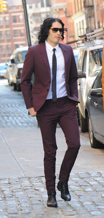 Russell in a maroon suit