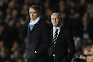 Roberto Mancini (left) Mark Hughes