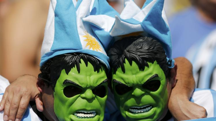 Fans of Argentina, wearing a masks of comic character the Hulk, are pictured before their 2014 World Cup Group F soccer match against Iran at the Mineirao stadium in Belo Horizonte