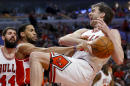 Chicago Bulls forward Pau Gasol, right, is fouled on the way to the basket by Washington Wizards guard Garrett Temple during the second half of an NBA basketball game, Tuesday, March 3, 2015, in Chicago. The Bulls won 97-92. (AP Photo/Kamil Krzaczynski)