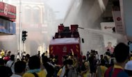 Protestors flee as water canon is sprayed to disperse demonstrators during an anti-government rally near Merdeka Square in Kuala Lumpur, on April 28. Malaysia has summoned Singapore's high commissioner over the involvement of three of the city-state's diplomats in the rally