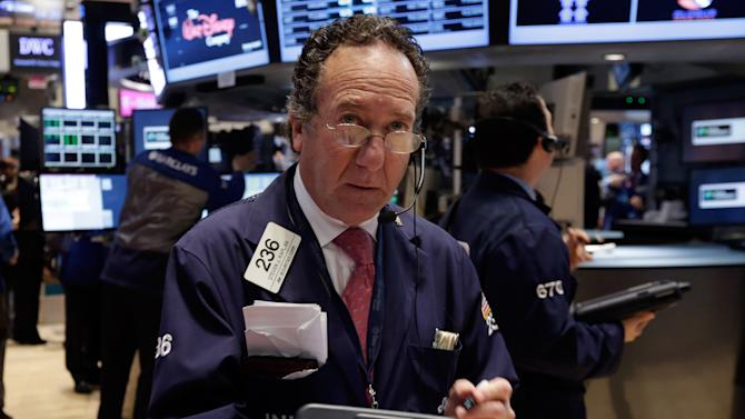 Trader Steven Kaplan works on the floor of the New York Stock Exchange Wednesday, May 1, 2013. The stock market is falling early after a survey showed U.S. companies added the fewest jobs in seven months and Merck reported a lower quarterly profit. (AP Photo/Richard Drew)