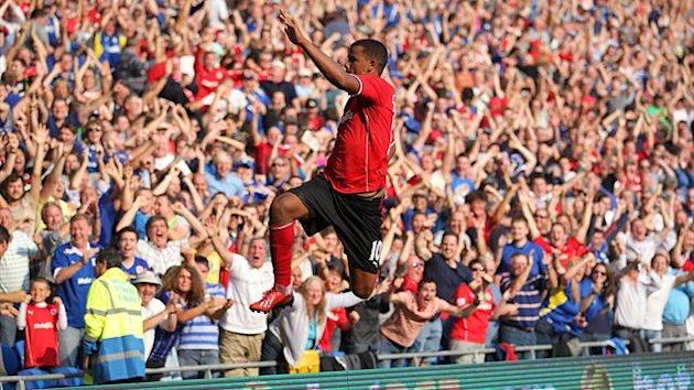 Frazier Campbell celebrates scoring for Cardiff against Manchester City (PA)